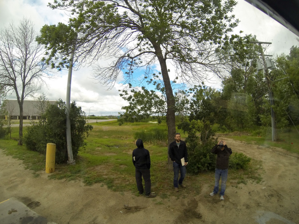 The GoPro was rolling while we waited for the officers to finish their inspection. That's Mechanic Guy on the right, and me with my pile of paperwork in the middle. Tree Guy on the left was probably looking at the surrounding vegetation.